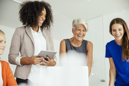 Happy businesswomen having a meeting in conference room - MFF002169