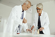 Two scientists working with liquids in lab - MFF002181
