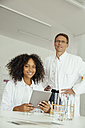 Two scientists with digital tablet in lab - MFF002187
