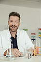 Portrait of smiling scientist in lab - MFF002196