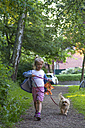 Little girl walking with her dog - JFEF000693