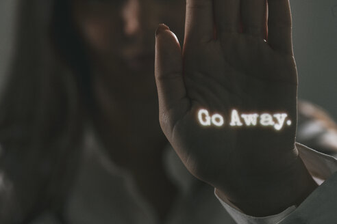 Woman with projected words on her palm - SEL000073