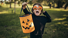 Masquerade little girl holding halloween lantern - MGOF000668