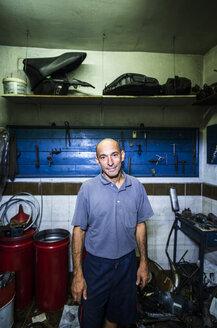 Portrait of mechanic in his workshop - JASF000103