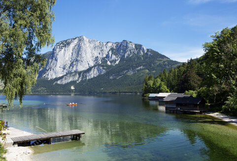 Austria, Styria, Altaussee, boat on lake with Trisselwand at Totes Gebirge - WWF003870
