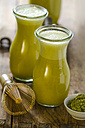 Two glass bottles of matcha smoothie - ODF001325