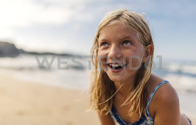 Portrait of smiling blond girl on the beach - MGOF000720