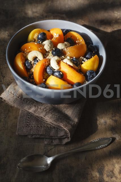 Bowl of muesli with cracked buckwheat, fruits, sesame and cashew nuts - EVGF002240