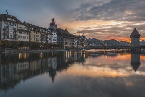 Switzerland, Lucerne, Old town, Chapel bridge at sunset - KEBF000252