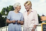 Germany, Berlin, portrait of two smiling senior women - TAMF000339