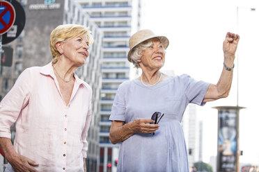 Germany, Berlin, portrait of two  senior women watching something - TAMF000340