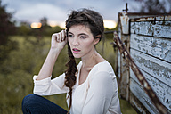Portrait of woman with braid at twilight - SHKF000370