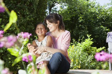 Happy mother and daughter in garden - RBF003228