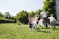 Playful family of five in garden - RBF003244