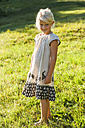 Portrait of smiling blond little girl wearing summer dress standing on a meadow - TCF004902