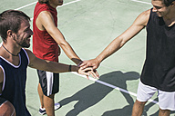 Three young men playing basketball - ABZF000123