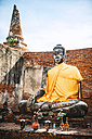 Thailand, Ayutthaya, view to ancient Buddha statue covered with yellow cloth - EHF000235
