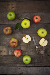 Different apples and pocket knife on wood - LVF003838