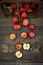 Red apples, sort Gala, basket and pocket knife on wood - LVF003847