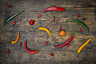 Different chili peppers on wood - LVF003883