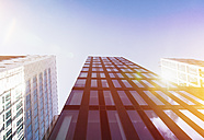 Bright sunshine reflecting in glass facades of modern office buildings - ZMF000430