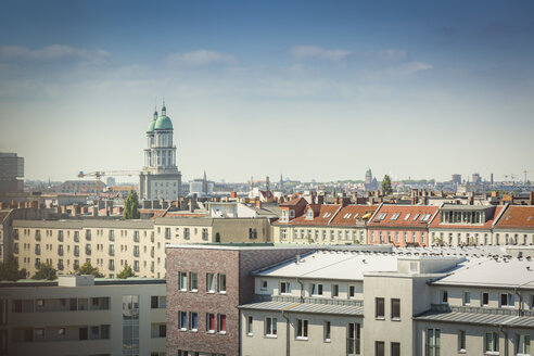 Germany, Berlin, Frankfurter Tor over the roofs of the surrounding buildings - NKF000404