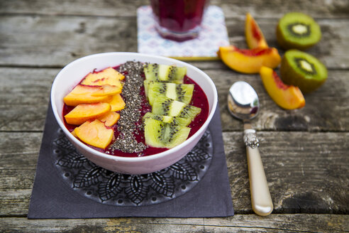 Smoothie with fruits and chia seeds in bowl - SARF002108