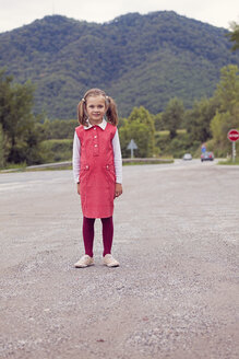 Portrait of little girl with braids wearing red dress - XCF000036