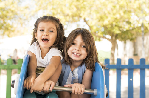 Two little girls playing on a playground - JASF000121