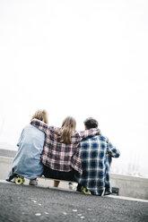 Three friends longboarding in the city - JRFF000103