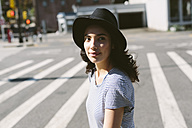 USA, New York City, portrait of young woman wearing black hat - GIOF000138