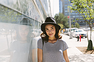 USA, New York City, portrait of young woman wearing black hat - GIOF000150