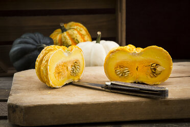 Different sorts of mini squashes with sliced Jack be Little in the foreground - LVF003917