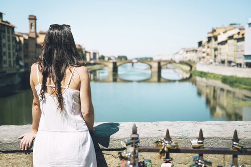 Italy, Florence, woman looking from Ponte Vecchio - GEMF000453