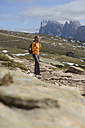 Italy, Alto Adige, Urtijei, hiker enjoying nature - LBF001233