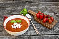 Bowl of homemade tomato soup on wood - SARF002159