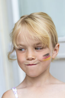 Portrait of blond little girl with German Flag painted on her cheek - JFEF000718