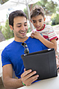 Portrait of father and son with digital tablet - ERLF000048