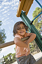 Portrait of smiling little girl on a playground - ERLF000057