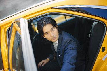USA, New York City, portrait of businessman entering a taxi - GIOF000248