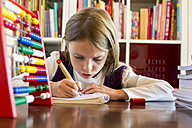 Girl doing homework - SARF002184