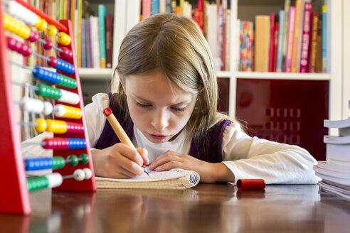 Girl doing homework - SARF002184