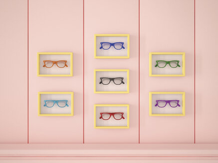 Colourful glasses in yellow frames hanging on pink wall - UWF000631