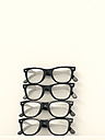 Four black glasses stacked on white background - UWF000634