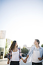 Spain, Reus, young couple in love walking around in the city - JRFF000127