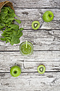 Glass of apple kiwi spinach smoothie and ingredients - LVF003961