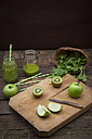 Two glasses of apple kiwi spinach smoothie and ingredients - LVF003970