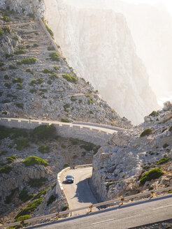 Spain, Mallorca, Cap Formentor, car driving on mountain road - AMF004325