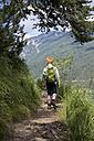 Austria, Tyrol, boy hiking at Achensee - JEDF000255