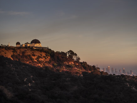 USA, Los Angeles, Griffith Observatory and city skyline at sunset - SBDF002311